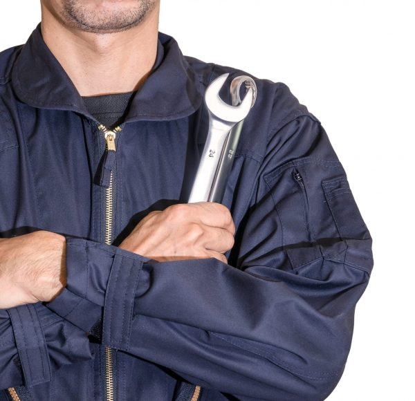 car-repairman-wearing-a-dark-blue-uniform-standing-and-holding-a-wrench-that-is-an-essential-tool-for_t20_lRewgg-scaled.jpg