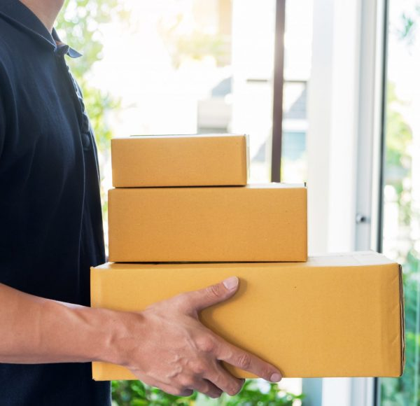 delivery-service-concept-customer-hand-receiving-a-cardboard-boxes-parcel-from-delivery-man-at-home_t20_P1KN4Q-scaled.jpg